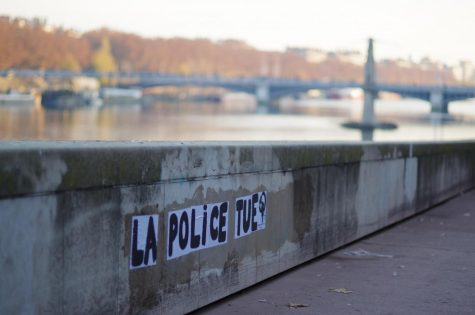 "A wall in Lyon, France reads ""The police kill"" in the wake of racially driven police brutality and a new bill that would punish citizens for recording police officers."