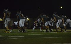 The Hornet defense faces off against the Mustangs.