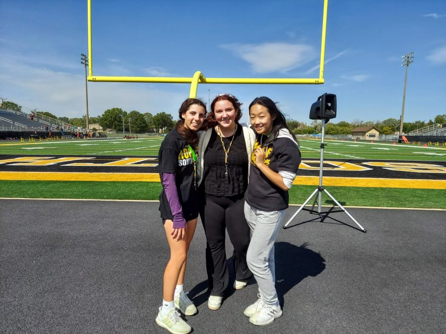 The bands Drum Majors (from left to right): Dana Euske, Izzy ONeill, and Grace Choi